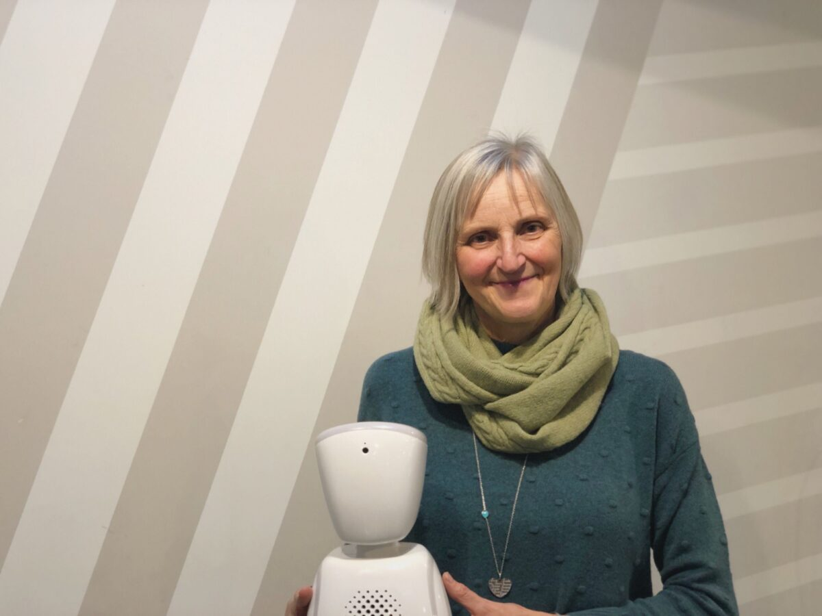 Julie Young from Somerset Council pictured holding an AV1 robot